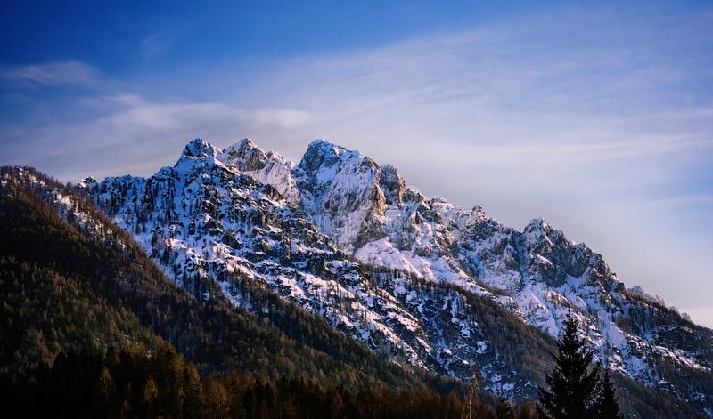 Mountain peak surrounded in clouds, Skrlatica mountain in the evening glow stock image