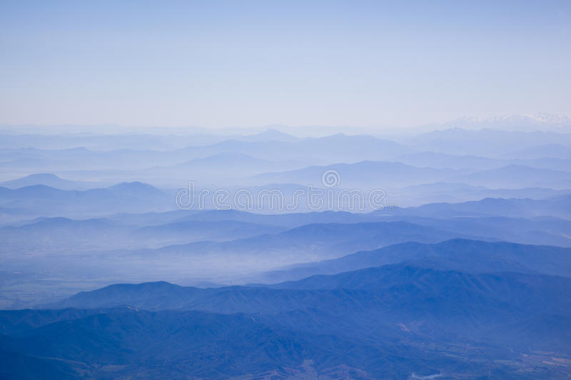 Mountain peaks and cloud stock photography