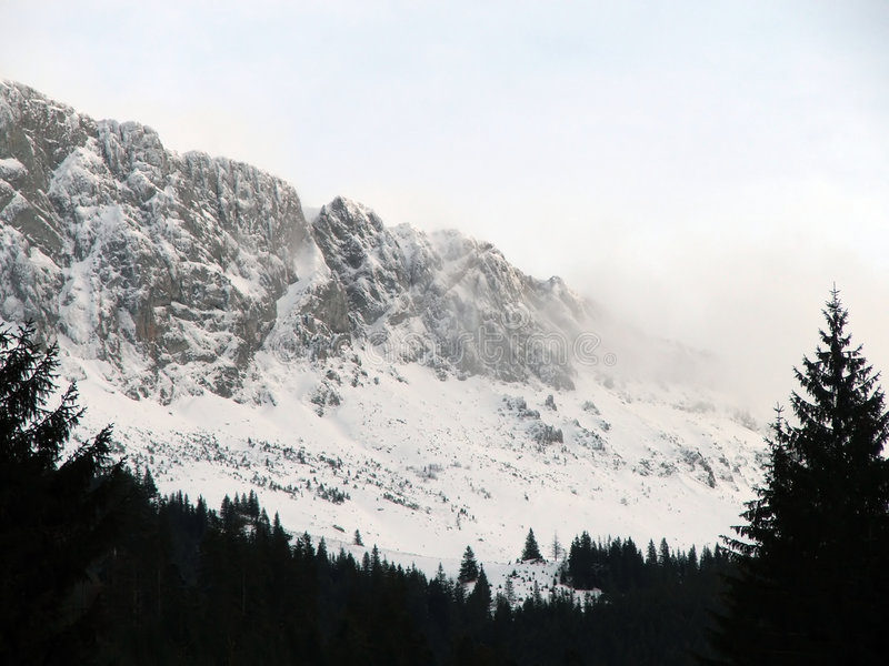 Download Mountain Peaks Covered By Clouds And Snow Stock Image - Image of branch, season: 428943