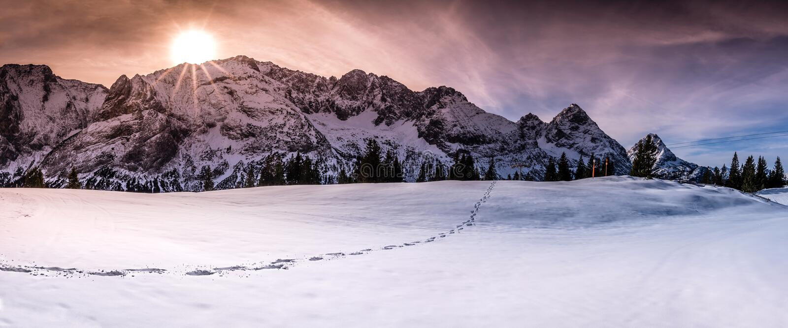 Mountain peaks with footsteps on snow royalty free stock photos