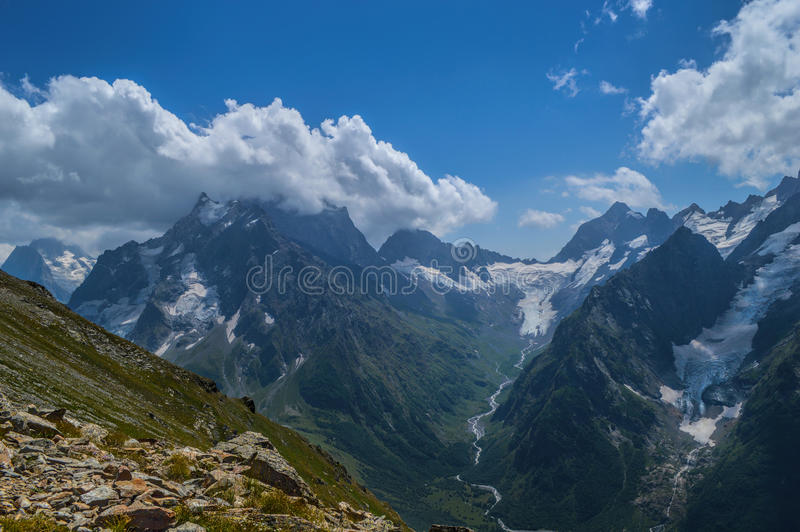 Mountain peaks, glaciers and valleys at Dombay region stock photo