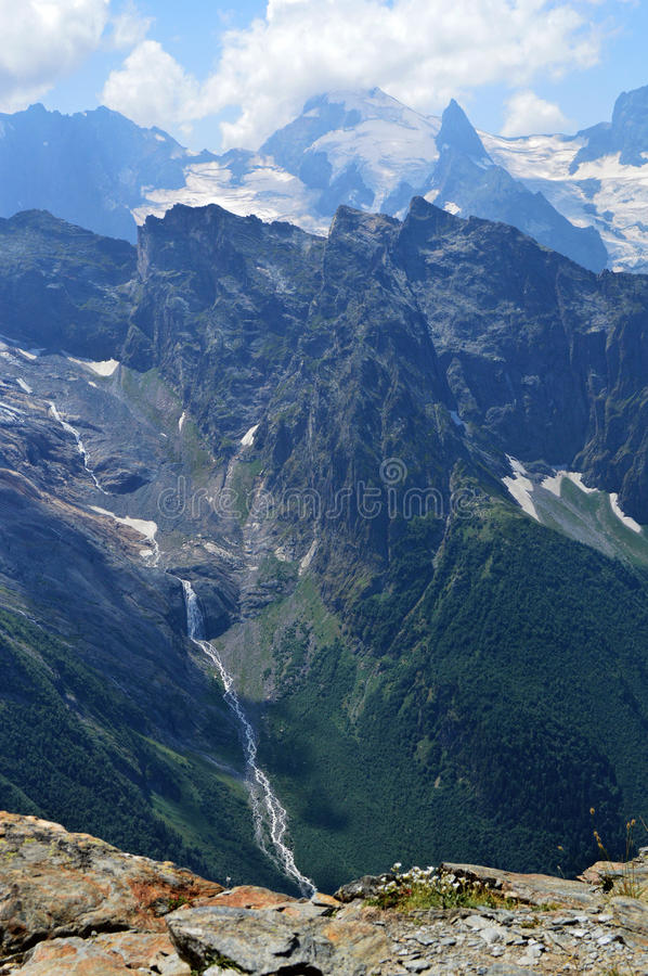 Mountain peaks, glaciers and valleys at Dombay region stock image