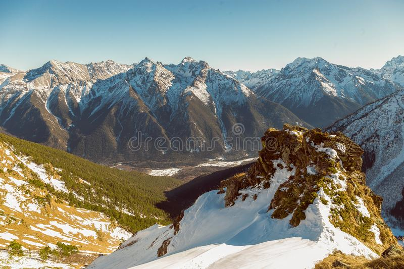 Mountain peaks and mountain slopes of the Caucasus. In the remains of snow in the spring day Dombay Karachay-Cherkessia royalty free stock photography