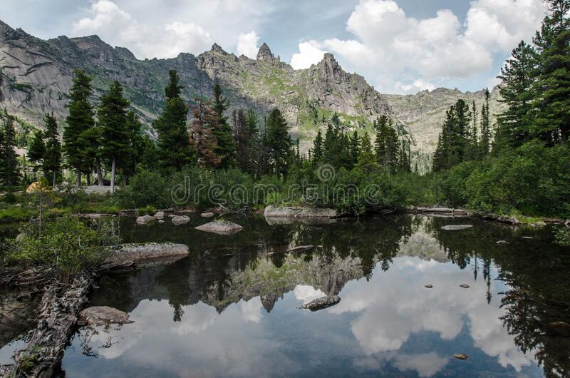 Mountain peaks reflected in the lake stock image