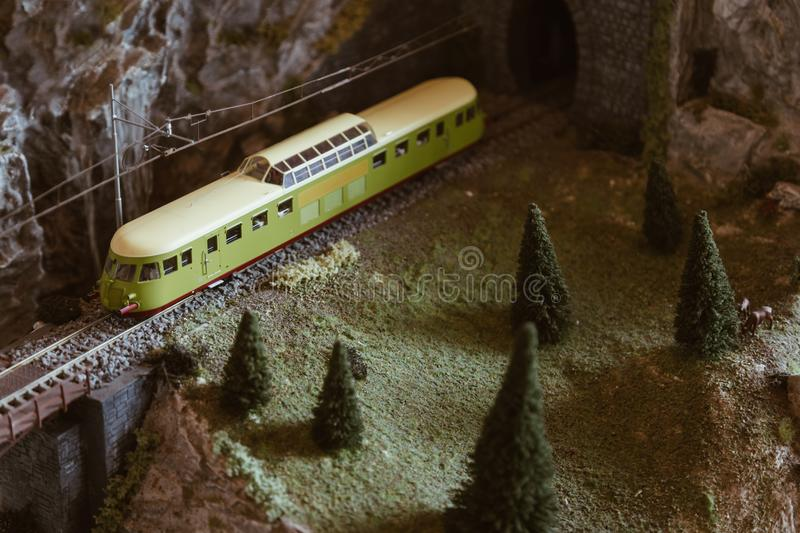 Mountain railway with vintage train on the miniature model stock images