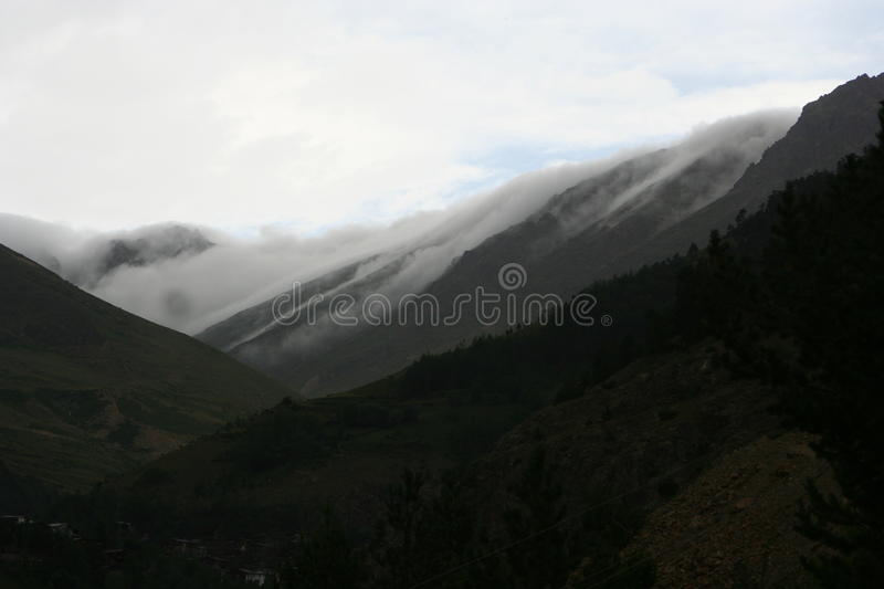 Mountain. The rain cloud comes from mountain stock photo