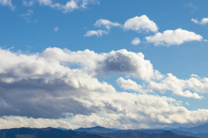 Mountain range in clear weather in contrasting rain clouds before the rain royalty free stock photo