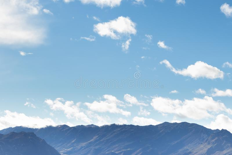Mountain range in clear weather in contrasting rain clouds before the rain royalty free stock images