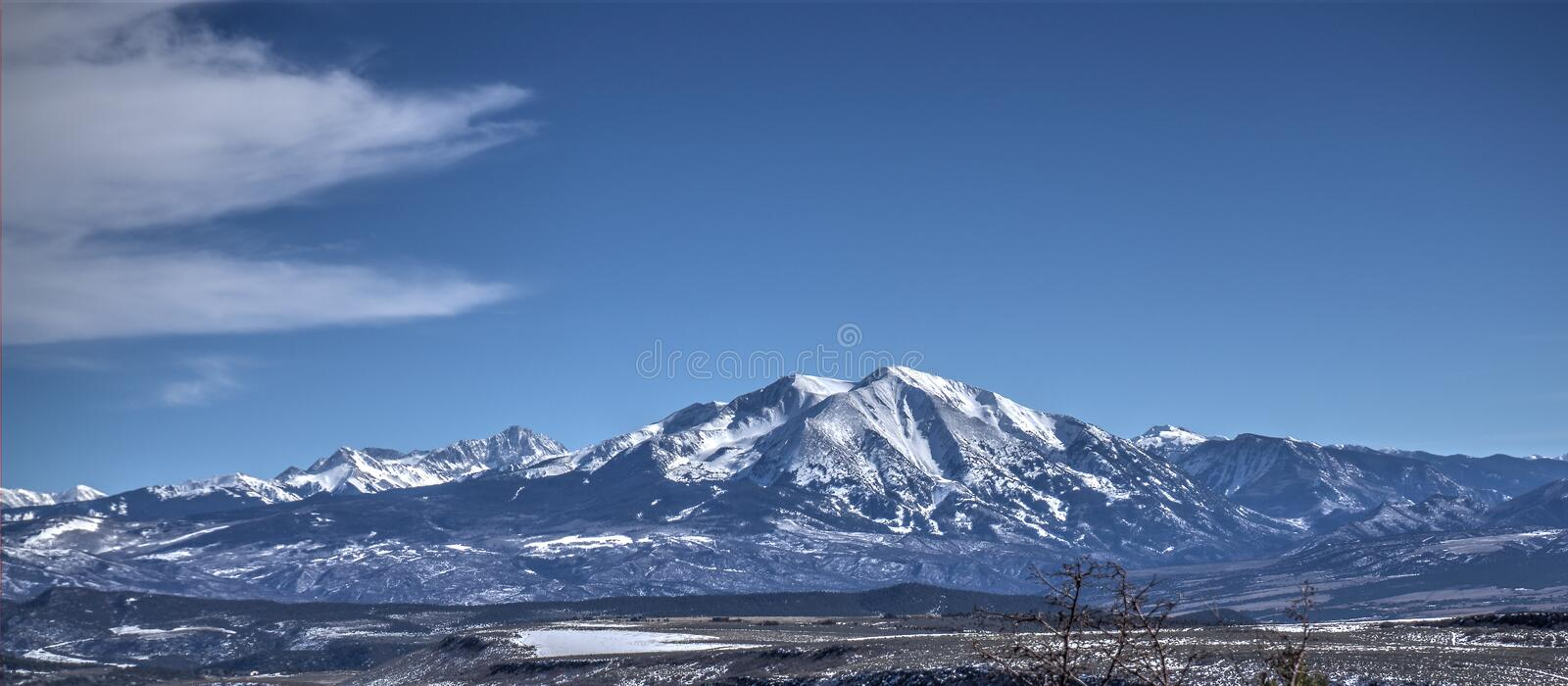 Mountain Range in Colorado with clouds and a snow capped top stock photos