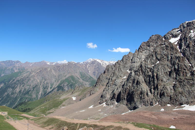 Mountain range, the height of 3300 meters. Travel in Kazakhstan, Alma-Ata, mountains, Summer, cold in the mountains royalty free stock image
