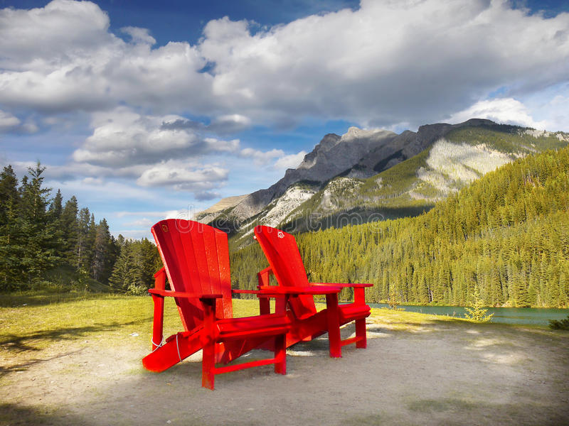 Mountain Range landscape, Rocky Mountains, Canada. Rocky Mountains, Canada. Mountain range landscape, chairs and lake view. Canadian Rockies, National Parks stock photography