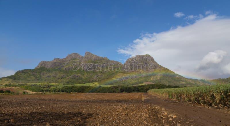 Mountain range in Mauritius with rainbow.  royalty free stock photo
