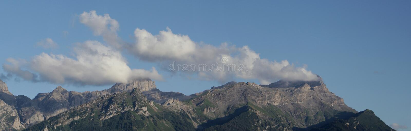 Mountain Range. Panoramic view of a mountain range in summer stock images