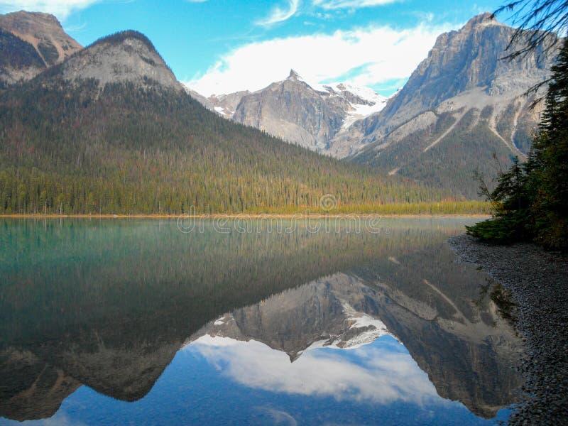 Emerald Lake during fall, Canada. A mountain range reflecting a perfectly calm Emerald Lake, Yoho. Canada stock images