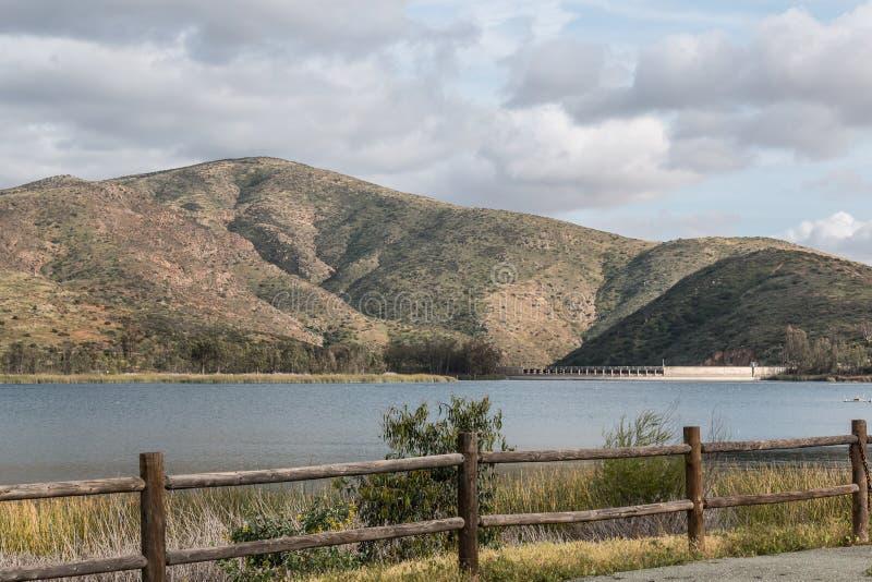Mountain Range, Reservoir, Lake and Fence stock image