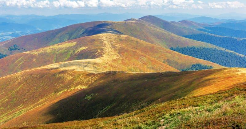 Mountain range rolling far away in to the horizon royalty free stock photo