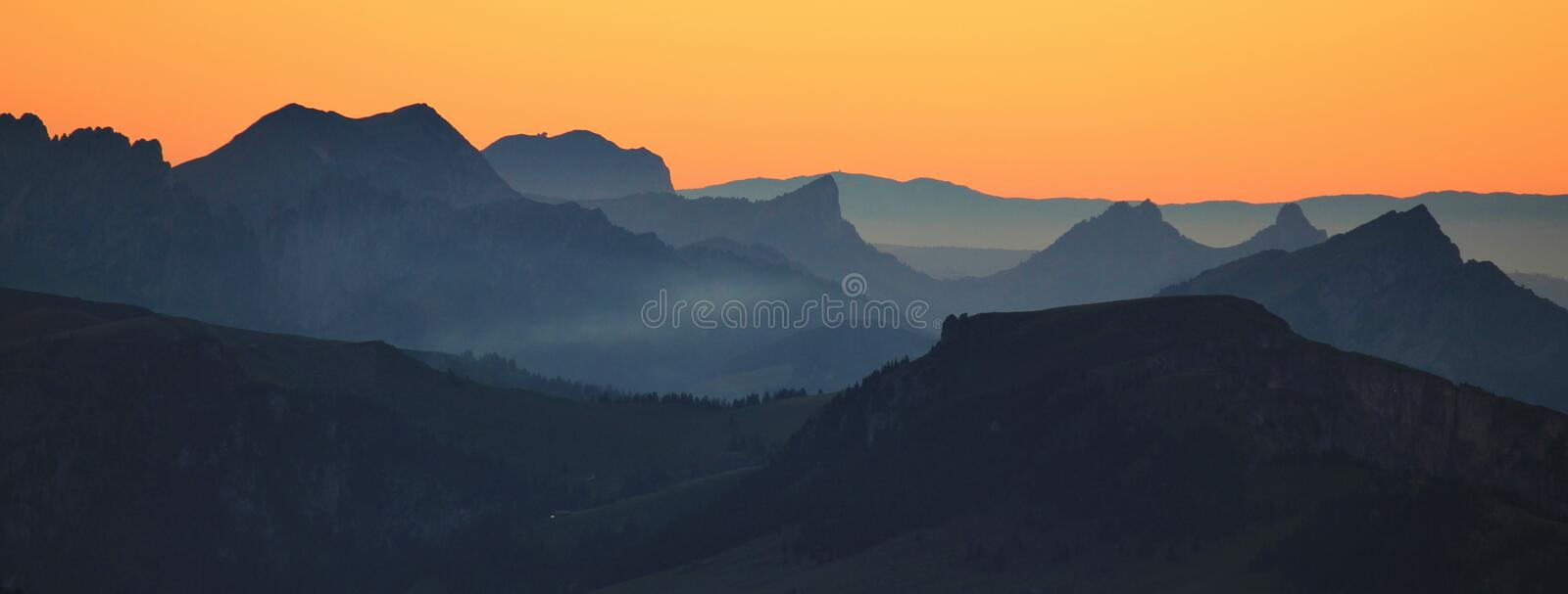 Mountain ranges seen from Mount Niesen. Mountain ranges seen from Mount Niesen at sunset. Landscape in Switzerland stock photos