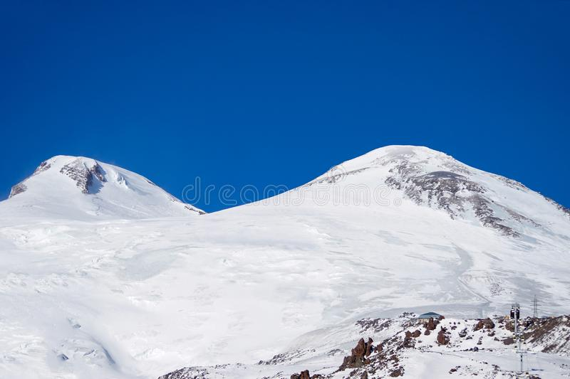 Mountain ranges. ski piler. Snowblower Snow plow for snowboarding and downhill skiing. The peaks of Elbrus. North Caucasus Russia stock photo