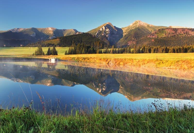 Mountain reflection in water - Belianske Tatry, Slovakia royalty free stock image
