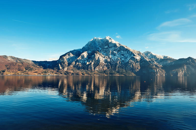 Mountain reflection in the water with sky stock photos