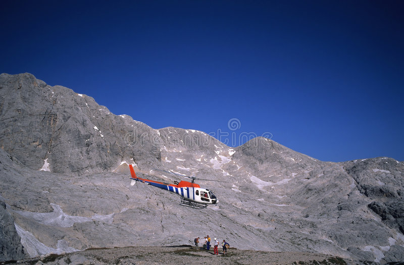Mountain rescue. Rescue helicopter in the Alps, Austria royalty free stock image