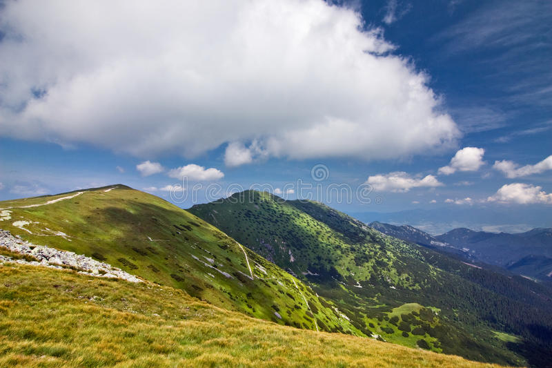 Download Mountain Ridge And Blue Sky With Clouds Stock Photo - Image: 20514324