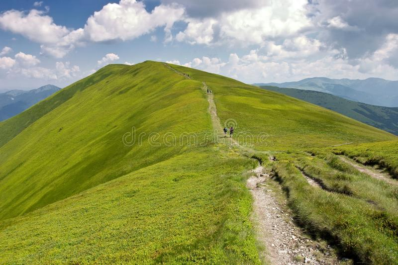 Mountain Ridge with Cloudy Skies in the Summer stock photo