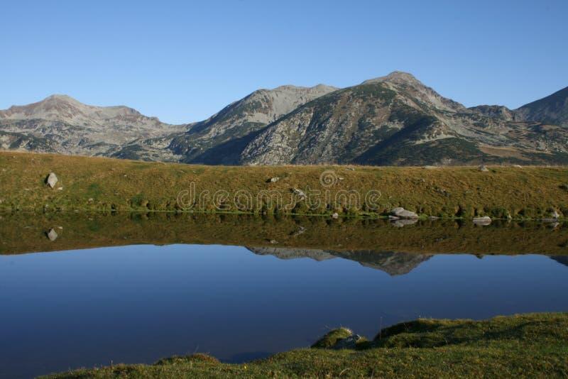 Mountain Ridge Reflection In A Lake Stock Image