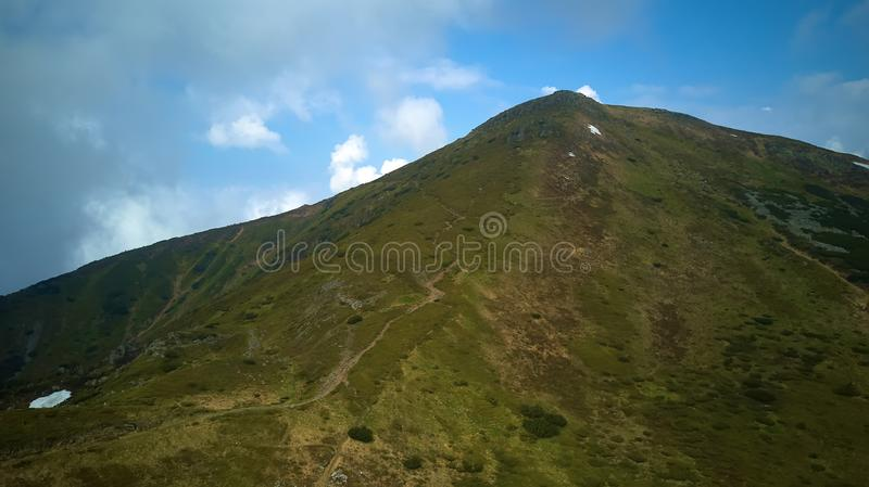 Mountain ridge with rocky outcrops. Panoramic view from the top of the ridge on background of valley. Carpathian royalty free stock photos