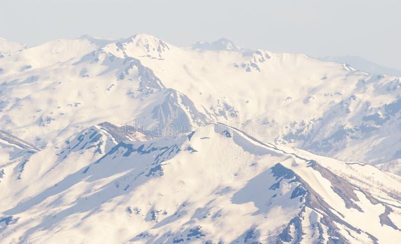Mountain ridge in a snow, winter mountain scene royalty free stock photography