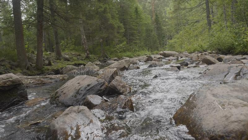 Mountain river in autumn time. Rocky shore. River flowing through Rocky Mountains stock photography