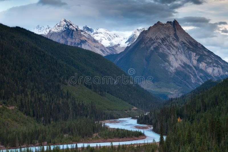 A mountain and river in the Canadian Rockies at sunset royalty free stock image