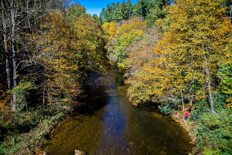 Mountain river and fall foliage in the Appalachians of western N. Orth Carolina near the Blue Ridge Parkway royalty free stock photo
