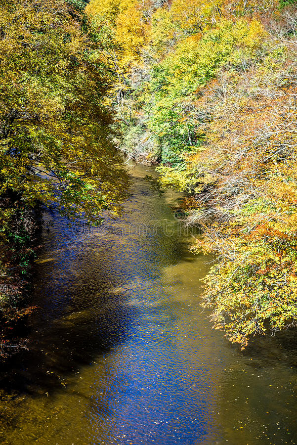 Mountain river and fall foliage in the Appalachians of western N. Orth Carolina near the Blue Ridge Parkway stock image