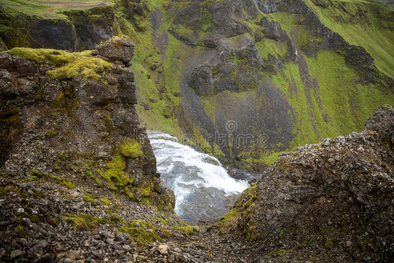 The mountain river flows among the green hills covered with moss. Somewhere in the mountains of Iceland royalty free stock photos