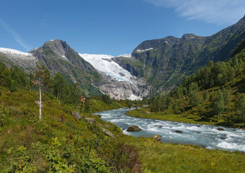 Mountain river formed by meltwater of glacier royalty free stock photography