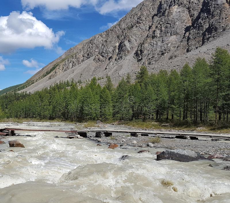 Mountain river from the glacier stock photo