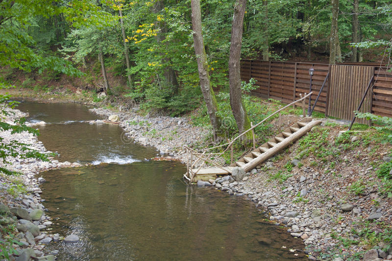Mountain river with ladder for swimming. In Carpathians, Ukraine stock photography