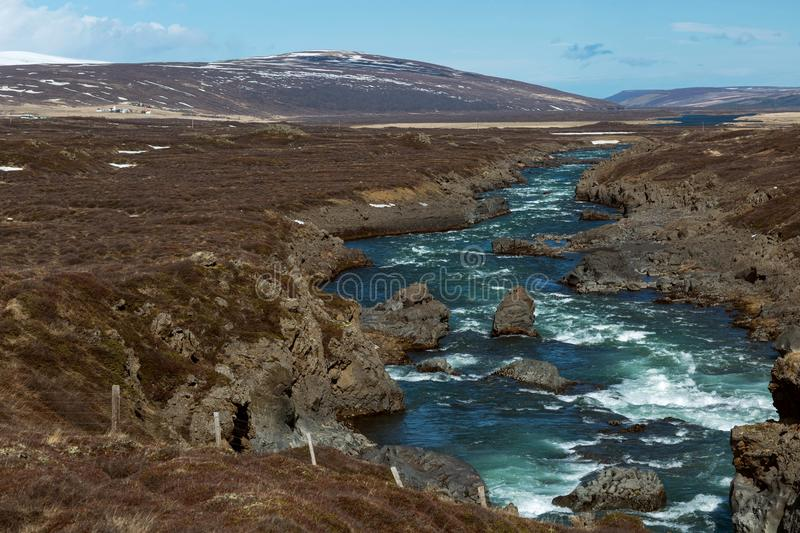 mountain river overlooking the snowy mountains, Iceland royalty free stock image