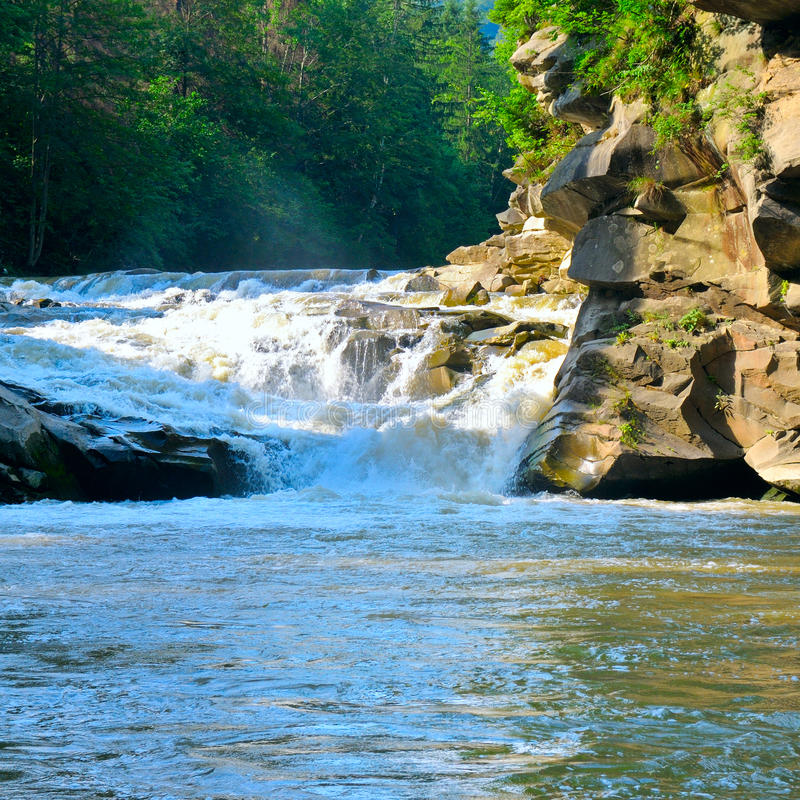 Mountain river, rocky coast and forest stock images