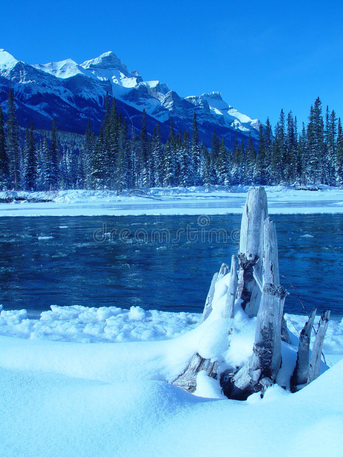 Mountain river after snowstorm stock photo