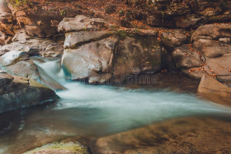 Mountain river stream closeup, large rocky rocks stock photography