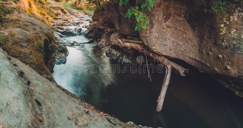 Mountain river stream closeup, large rocky rocks royalty free stock image