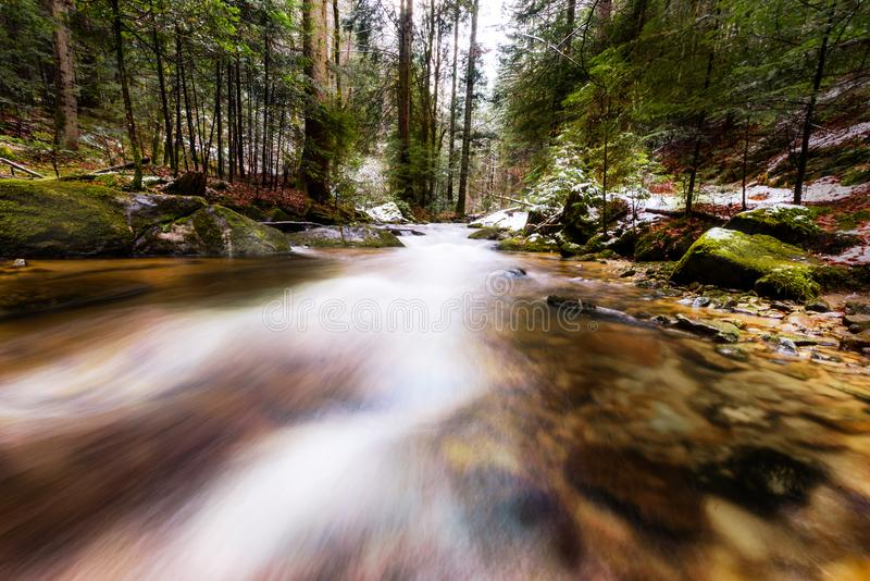 Mountain river, stream, creek with rapids in late autumn, early winter with snow, vintgar gorge, Slovenia royalty free stock photo