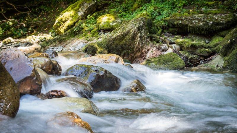 Mountain river. Water on rocks. stock photos