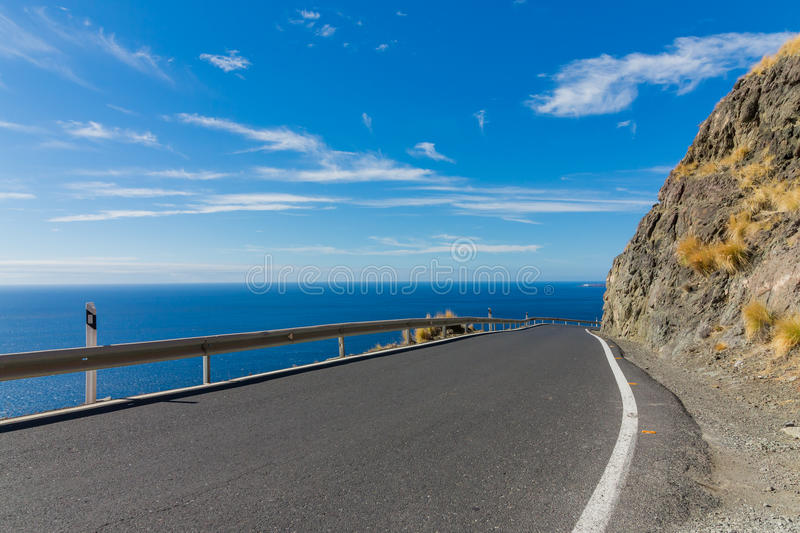 Mountain road along the sea-cliff royalty free stock image