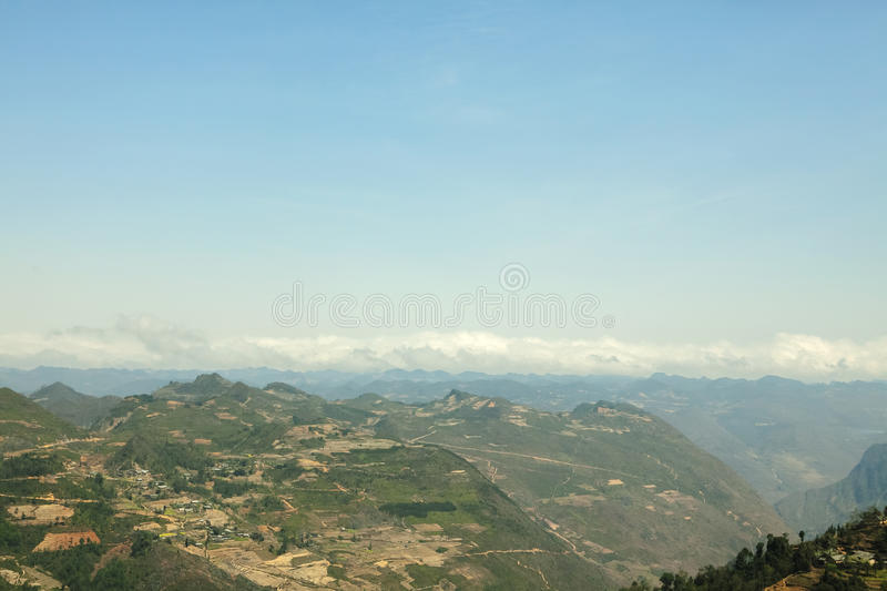 Mountain, road and cloud, blue sky at Lung Cu. In Van stone. Van Stone Plateau (natural or painted Van) is a rocky plateau spread over four districts of Quan Ba royalty free stock image