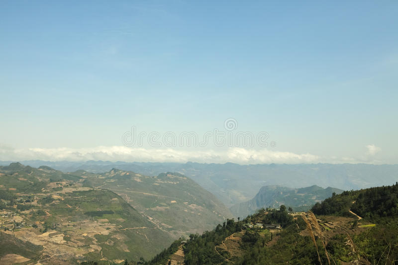 Mountain, road and cloud, blue sky at Lung Cu. In Van stone. Van Stone Plateau (natural or painted Van) is a rocky plateau spread over four districts of Quan Ba stock photos