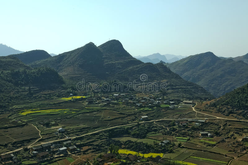 Mountain, road and cloud, blue sky at Lung Cu. In Van stone. Van Stone Plateau (natural or painted Van) is a rocky plateau spread over four districts of Quan Ba stock photography