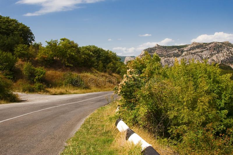 Mountain road in the Crimean mountains in the summer. Mountain road in the Crimean mountains in the summer royalty free stock photo